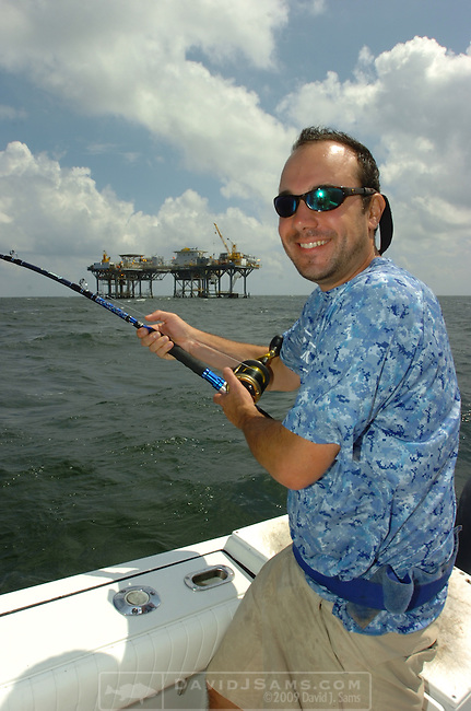 OFFSHORE FISHING.Peter Angle shows a king mackerel caught on bomber trolling bait est. 35 pounds.near oil production platform.fishing with CApt. Peace Marvel....Venice, Louisiana