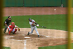 As viewed through the right field foul pole, the Braves Brian Jordan (batting) connects for what was originally ruled a home run, but then controversially changed to a foul ball in the top of the seventh inning on Monday, May 30, 2005. The Washington Nationals defeated the Atlanta Braves 3-2 at RFK Stadium in Washington, DC.
