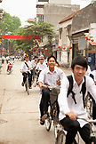 VIETNAM, Hanoi, Bathranag Village, kids ride their bikes home at the end of the school day