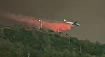Bear Valley, California-July 26, 2008-Telegraph Fire near Yosemite National Park..Tanker drop retardant on Mt. Bullion Ridge to protect Cell phone tower on Fremont Peak.  Image taken from Highway 49. Between Mt. Bullion and Bear Valley. .Photo by Al GOLUB/Golub Photography.