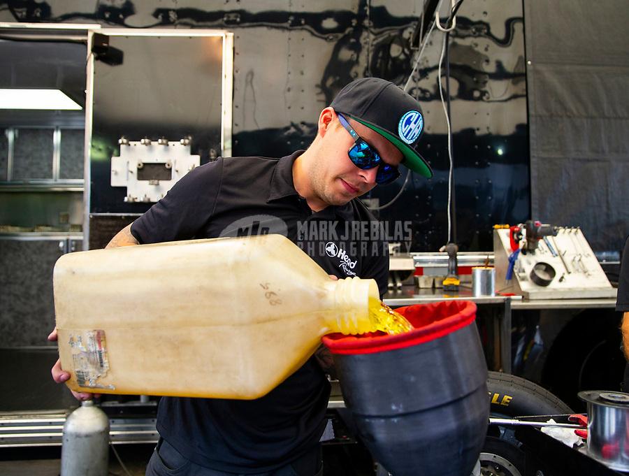 May 5, 2018; Commerce, GA, USA; NHRA funny car driver Jonnie Lindberg pours nitromethane fuel into the tank of his car during qualifying for the Southern Nationals at Atlanta Dragway. Mandatory Credit: Mark J. Rebilas-USA TODAY Sports