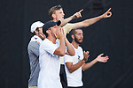 Julian Zlobinsky, Ian Dempster, Christian Seraphim, and Petros Chrysochos of the Wake Forest Demon Deacons cheer for their teammate Bar Botzer (not pictured) during the match against the Ohio State Buckeyes during the 2018 NCAA Men's Tennis Championship at the Wake Forest Tennis Center on May 22, 2018 in Winston-Salem, North Carolina.  The Demon Deacons defeated the Buckeyes 4-2. (Brian Westerholt/Sports On Film)