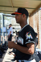 GCL Marlins pitcher Aneury Osoria (10) in the dugout during the first game of a doubleheader against the GCL Mets on July 24, 2015 at the St. Lucie Sports Complex in St. Lucie, Florida.  GCL Marlins defeated the GCL Mets 5-4.  (Mike Janes/Four Seam Images)
