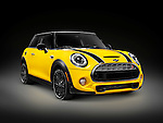 Yellow 2014 Mini Cooper S, Mini Hatch, hatchback compact city car isolated on black background with clipping path