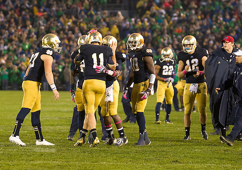 October 13, 2012:  Notre Dame quarterback Tommy Rees (11) is congratulated by teammates after throwing overtime touchdown pass during NCAA Football game action between the Notre Dame Fighting Irish and the Stanford Cardinal at Notre Dame Stadium in South Bend, Indiana.  Notre Dame defeated Stanford 20-13.