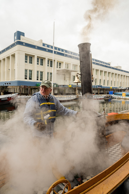 2/6/2016 &mdash; Lake Union, Seattle, WA<br /> <br /> &ldquo;Puffin&rdquo;, a little steam launch built in 1906, is one of the most popular boats at the Center for Wooden Boats on Seattle&rsquo;s Lake Union and is maintained almost exclusively by volunteers. It has taken thousands of visitors on free Sunday tours of Lake Union since the mid 1990s.<br /> <br /> HERE: Volunteer Jeff Deren  prepares the Puffin for a trip.<br /> <br /> Puffin is a picky boat when it comes to burning wood. To get the most fire power, volunteers feed the boiler with fine hardwoods donated by Dusty Springs, a local manufacturer of harps and violins.<br /> <br /> Photograph by Stuart Isett<br /> &copy;2015 Stuart Isett. All rights reserved.