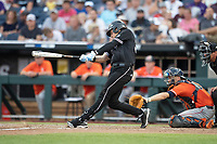 Mississippi State Bulldogs third baseman Marshall Gilbert (34) swings the bat during Game 4 of the NCAA College World Series against the Auburn Tigers on June 16, 2019 at TD Ameritrade Park in Omaha, Nebraska. Mississippi State defeated Auburn 5-4. (Andrew Woolley/Four Seam Images)