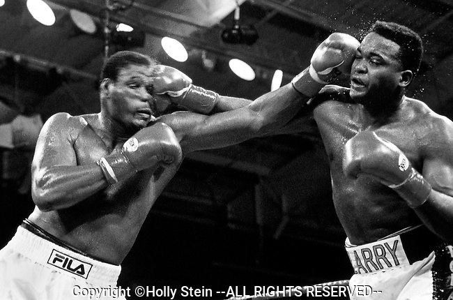 Riddick Bowe v. Larry Johnson.