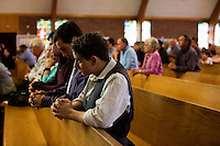 "From right, triplet sons Sean Arnold, Scott Arnold, and Christian Arnold (all 17), mother Christine Arnold (in blue), and grandparents Joanmarie and Tom Gorman, all of Scituate, take part in the last service at St. Frances Xavier Cabrini Church in Scituate, Mass., on Sun., May 29, 2016. Members of the congregation have been holding a vigil for more than 11 years after the Archdiocese of Boston ordered the parish closed in 2004. For 4234 days, at least one member of Friends of St. Frances X. Cabrini has been at the church at all times, preventing the closure of the church. May 29, 2016, was the last service held at the church after members finally agreed to leave the building after the US Supreme Court decided not to hear their appeal to earlier an Massachusetts court ruling stating that they must leave. The last service was called a ""transitional mass"" and was the first sanctioned mass performed at the church since the vigil began."