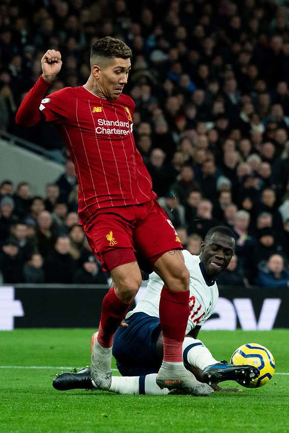Tottenham's Davinson Sanchez battles for possession with Liverpool's Roberto Firmino <br /> <br /> Photographer Stephanie Meek/CameraSport<br /> <br /> The Premier League - Tottenham Hotspur v Liverpool - Saturday 11th January 2020 - Tottenham Hotspur Stadium - London<br /> <br /> World Copyright © 2020 CameraSport. All rights reserved. 43 Linden Ave. Countesthorpe. Leicester. England. LE8 5PG - Tel: +44 (0) 116 277 4147 - admin@camerasport.com - www.camerasport.com