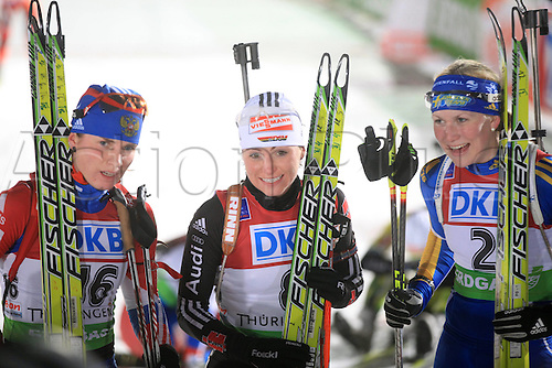 09.01.2011 IBU World Cup Biathlon from Oberhof Germany. Picture shows Andrea Henkel Germany celebrating next to Helena of Sweden and Svetlana Sleptsova Russia.