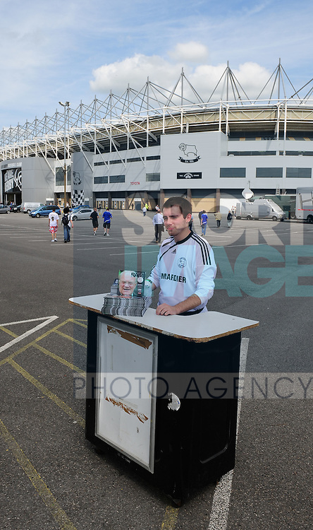 Programme seller outside Pride Park home of Derby County