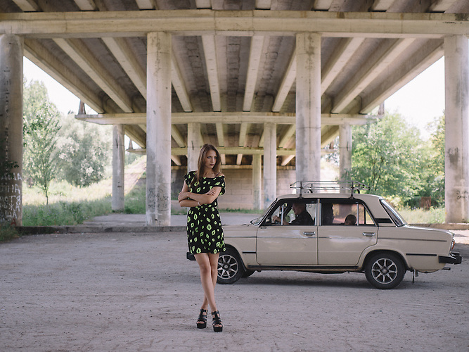 Katrine stands under the bridge in Ribnita, Transnistria.