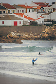 3rd January 2018,  Baleal, Peniche Portugal - Surfers enter the water after a practice session in January 3rd , before the upcoming Nazare big-wave surfing event which will have giant wave runs