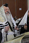 The Rabbi of the Premishlan congregation is reading the Purim Megillah
