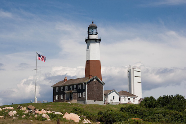 Montauk Point Lighthouse and the American flag on eastern Long Island, Montauk, New York. .  John offers private photo tours in Denver, Boulder and throughout Colorado. Year-round.