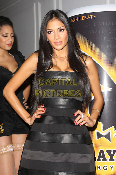 NICOLE SCHERZINGER .Attending the Playboy Energy Drink UK Launch Party at Funky Buddha, London, England, UK, November 18th 2010..half length strapless black dress hands on hips .CAP/AH.©Adam Houghton/Capital Pictures.
