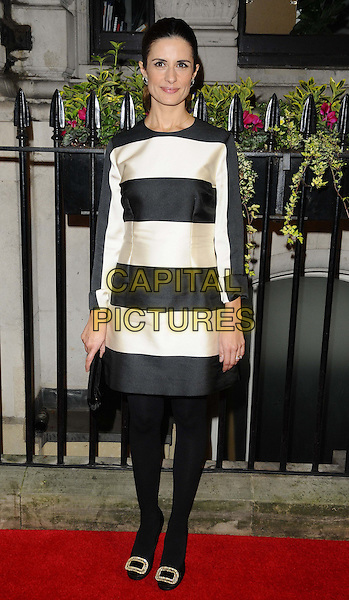 Livia Firth (nee Giuggioli)<br /> attending the BFI Luminous Gala Dinner, 8 Northumberland Avenue, London, England.<br /> 8th October 2013<br /> full length black white stripe dress tights <br /> CAP/CAN<br /> &copy;Can Nguyen/Capital Pictures