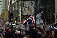 NEW YORK, NY - APRIL 15: Activists pass near Trump Tower as they take part in a Tax Day protest on April 15, 2017 in New York City. Thousands of activists march to Trump Tower to demand that President Donald Trump release his tax returns. Photo by VIEWpress/Eduardo MunozAlvarez