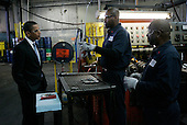Bedford Heights, OH - January 16, 2009 -- United States President Elect Barack Obama (L) talks with workers at Cardinal Fastener & Specialty Company, Inc., in Bedford Heights, Ohio, USA, 16 January 2009.  Obama met with workers at the plant, which manufactures parts used to construct wind turbines, to discuss an American Recovery and Reinvestment Plan, which would aim to create nearly half a million American jobs by investing in clean energy.  .Credit: David Maxwell - Pool via CNP