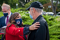Comedian Jon Stewart, right, embraces Rosie Torres, whose husband Army Capt. (retired) LeRoy Torres died from complications from exposure to burn pits, prior to a press conference regarding legislation to assist veterans exposed to burn pits, outside the US Capitol in Washington, DC., Tuesday, September 15, 2020. <br /> Credit: Rod Lamkey / CNP /MediaPunch