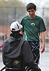 Bobby Bellino of Harborfields, right, chats with doubles partner Nate Melnyk as rain intensifies during their varsity boys tennis match against host Smithtown High School East on Tuesday, Apr. 29, 2016. Melnyk, a wheelchair-using junior, played in his first varsity match, which was suspended in the first set due to the inclement weather. The match is set to resume on Monday, May 2.