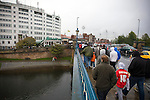 Supporters making their way in the rain over the River Trent towards the City Ground, Nottingham to watch their team, Nottingham Forest take on visitors Ipswich Town in an Npower Championship match. Forest won the match by two goals to nil in front of 22,935 spectators.
