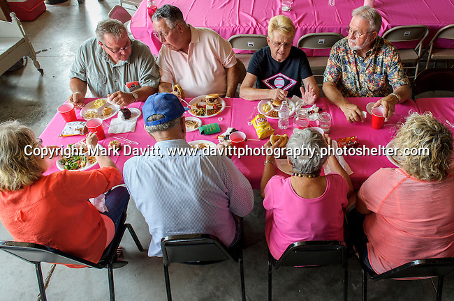 Neighbors and friends from all over central Iowa attended the Pink Tractor Foundation fifth annual fundraiser in support of fighting cancer in St. Marys at the Brommel family farm Saturday, June 11.