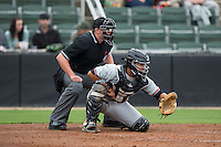 Hickory Crawdads catcher Jose Trevino (7) sets a target as home plate umpire Jacob Metz looks on during the game against the Kannapolis Intimidators at CMC-Northeast Stadium on April 17, 2015 in Kannapolis, North Carolina.  The Crawdads defeated the Intimidators 9-5 in game one of a double-header.  (Brian Westerholt/Four Seam Images)