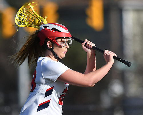 Erin Vaughan Ware #28 fakes a pass before cutting to the net in the first half of a Nassau County varsity girls lacrosse game against Mepham at MacArthur High School on Monday, March 20, 2017. She tallied three goals and four assists. Her final goal drew her within one of the school's career record of 147 held by Candace Noakes. Vaughan Ware will have the opportunity to break that record during the Lady Generals' next game, which is scheduled for Saturday, March 25 10:00AM against Clarke at MacArthur High School.