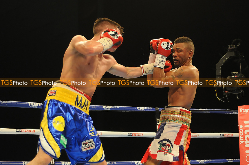 Martin J Ward (Blue and Yellow Shorts) defeats Ruddy Encarnacion on points during a Boxing show at the First Direct Arena on 16th April 2016
