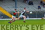 Kieran Murphy Kilcummintracks Darragh O'Doherty Legion during their SFC clash in Fitzgerald Stadium on Sunday