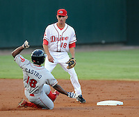 Shortstop Derrik Gibson (18) of the Greenville Drive waits for the throw as Leandro Castro (18) of the Lakewood BlueClaws steals second base in Game 1 of the South Atlantic League Championship Series on Sept. 13, 2010, at Fluor Field at the West End in Greenville, S.C. Photo by: Tom Priddy/Four Seam Images