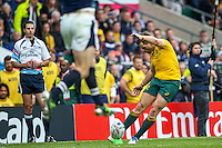 Bernard Foley kicks for goal as referee Craig Joubert looks on during the Rugby World Cup 2015 rugby union match between Australia and Scotland at Twickenham, England on 18 October 2015. No unauthorized download. Photo: Dean Woodgate / rainywoodphotography.co.uk