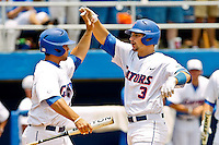 June 12, 2011:   Florida Gators catcher Mike Zunino (3) is congratulated by inf/of Preston Tucker (25) after hitting a home run during NCAA Gainesville Super Regional Game 3 action between Florida Gators and Mississippi State Bulldogs played at Alfred A. McKethan Stadium on the campus of Florida University in Gainesville, Florida.  Florida defeated Mississippi State 8-6 to advance to the College World Series in Omaha, Nebraska........