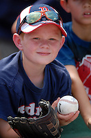 A young fan in search of autographs at the 2011 Futures at Fenway minor league doubleheader featuring the Portland Sea Dogs and the Binghamton Mets on August 20, 2011 at Fenway Park in Boston, Massachusetts. (Ken Babbitt/Four Seam Images)