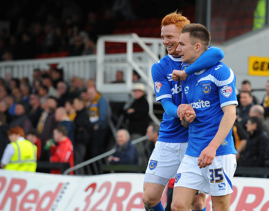 Portsmouth's Jed Wallace (right) celebrates scoring his sides second goal with team-mate Ryan Taylor<br /> <br /> Photo by Kevin Barnes/CameraSport<br /> <br /> Football - The Football League Sky Bet League Two - Newport County AFC v Portsmouth - Saturday 29th March 2014 - Rodney Parade - Newport<br /> <br /> &copy; CameraSport - 43 Linden Ave. Countesthorpe. Leicester. England. LE8 5PG - Tel: +44 (0) 116 277 4147 - admin@camerasport.com - www.camerasport.com