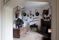 African hunting trophies brought back by Nora Parsons, wife of Manning Durdin-Robertson, line the walls of the entrance hall