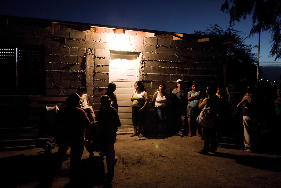"Villa El Libertador, Cordoba, Argentina...""If the life we live is not dignified, our dignity is the struggle to change it."".The line of people waiting to discuss their future house in ""El Libertador"" with the cooperative that organized the take..La Toma - the take of a piece of land, left uncultivated for years by the great soya entrepreneurs in Argentina. Around 250 families have decided to take the situation in their own hands, fighting to gain the right to have a house, while waiting for the state and the local authorities to face the serious living conditions and disoccupation problems in the shantytowns of Argentinas second biggest city Cordoba."