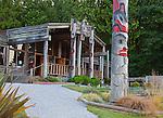 Blake Island State Park, WA  <br /> Totem pole stands in front of long house entrance at Tillikum Village