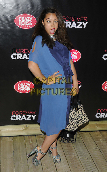 Marawa (cabaret artist).Forever Crazy by Crazy Horse VIP Gala Night at South Bank, London, England..September 19th 2012.full length blue dress hand on hip mouth open funny grey gray shoes sandals heels leopard print bag purse .CAP/CAN.©Can Nguyen/Capital Pictures.