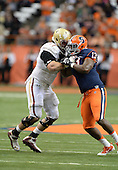 Boston College Eagles offensive lineman Matt Patchan (77) blocks defensive end Ron Thompson (13) during a game against the Syracuse Orange at the Carrier Dome on November 30, 2013 in Syracuse, New York.  Syracuse defeated Boston College 34-31.  (Copyright Mike Janes Photography)
