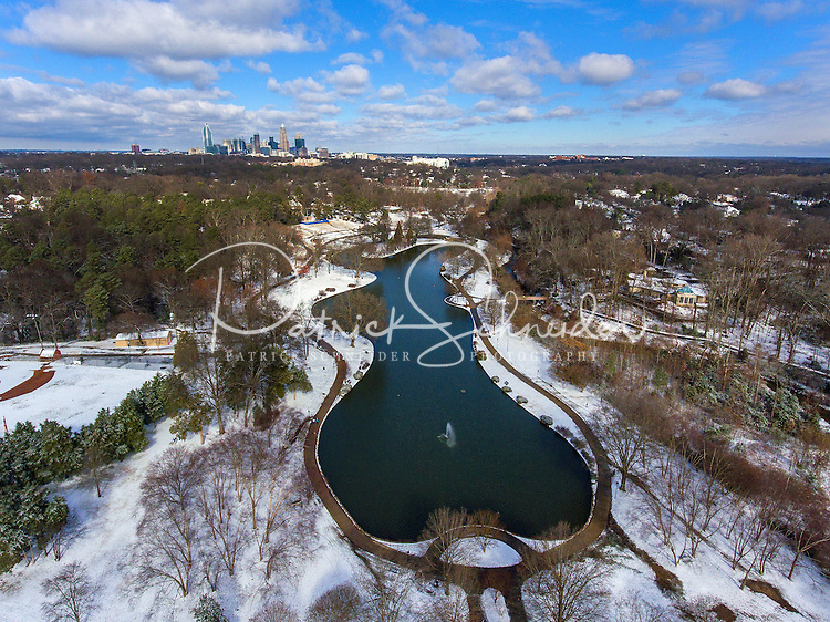Charlotte Snow Photography - Photography of a snow covered  Freedom Park in Charlotte North Carolina . <br />   <br /> The uptown Charlotte North Carolina skyline can be seen over a snow covered Freedom Park. <br /> <br /> <br /> Charlotte Photographer - PatrickSchneiderPhoto.com