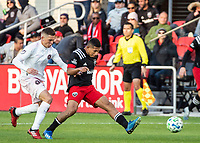 WASHINGTON, DC - MARCH 07: Edison Flores #10 of DC United kicks the ball away from Wil Trapp #6 of Inter Miami during a game between Inter Miami CF and D.C. United at Audi Field on March 07, 2020 in Washington, DC.