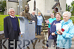REMEMBERING: Relative and friends of the late Fr Gerry Roche of Athea beside him memorial in the village with copies of the new DVD on his life and times, l-r: Pat Roche, Noel Roche, Peggy Casey, Margaret Roche, Mary Ann Stack, Nora Cunningham.