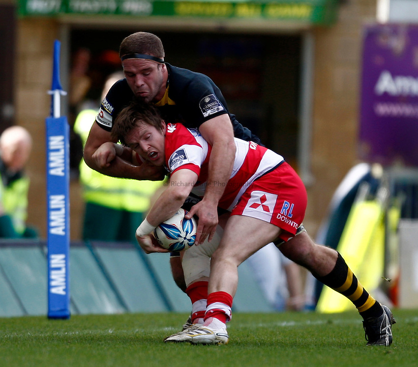 Photo: Richard Lane/Richard Lane Photography. London Wasps v Gloucester Rugby. Amlin Challenge Cup Quarter Final. 11/04/2010. Wasps' Joe Worsley tackles Gloucester's  Freddie Burns.
