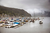 CANADA, Vancouver, British Columbia, a sailboat departs Deep Cove and heads into the Burrard Inlet, North Vancouver