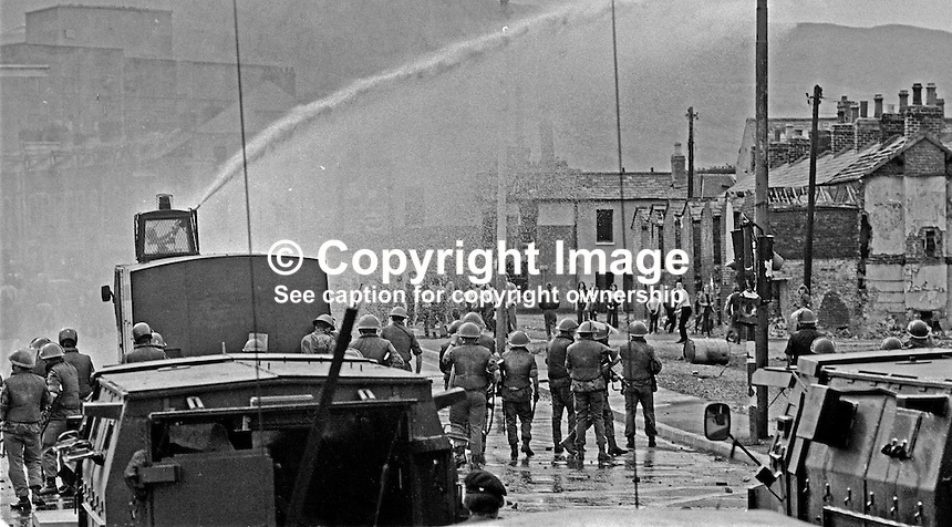 British soldiers use a water canon against rioters on the Lower Falls Road area of Belfast. The rioting broke out following a People's Democracy march which was prevented by soldiers and police from entering the city centre in Belfast, N Ireland. The march was in support of PD leaders Michael Farrell and Tony Canavan who were on hunger strike seeking political status in Belfast's Crumlin Road Jail.  29 July 1973, 197307290522f<br />