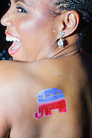 Amani Council, Executive Assistant to American Airlines' Radney Robertson, poses with her newly acquired GOP logo temporary airbrush tattoo at the MSNBC After Party at the United States Institute of Peace in Washington, DC. The party followed the annual White House Correspondents Association Dinner on Saturday, April 30, 2016. The party continued until about 3 AM on Sunday, May 1, 2016.