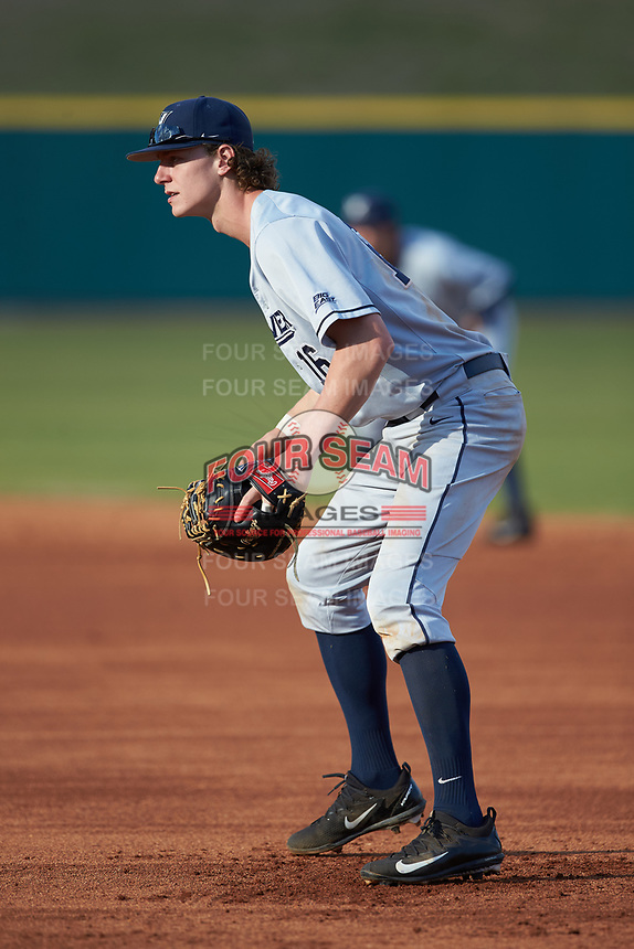 Ethan Schmidt (16) of the Xavier Musketeers on defense against the Penn State Nittany Lions at Coleman Field at the USA Baseball National Training Center on February 25, 2017 in Cary, North Carolina. The Musketeers defeated the Nittany Lions 7-5 in game two of a double header. (Brian Westerholt/Four Seam Images)